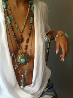 Sexy boho chic layered necklaces in turquoise and silver for an ethnic tribal look. For the BEST Bohemian fashion ideas FOLLOW https://www.pinterest.com/happygolicky/the-best-boho-chic-fashion-bohemian-jewelry-gypsy-/ now