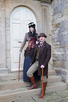 Steampunk Couple with Matching Canes  - For costume tutorials, clothing guide, fashion inspiration photo gallery, calendar of Steampunk events, & more, visit SteampunkFashionGuide.com