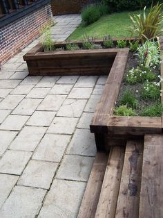 Paul Newman Designs - Raised Planters. Design planter in slope to border patio but cover part with top for bench seating.
