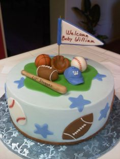 Sports Themed Baby Shower Cake - Did another sports themed baby shower for the next day.  This one is dark chocolate cake filled with fresh strawberries and iced in buttercream.  Fondant decorations.