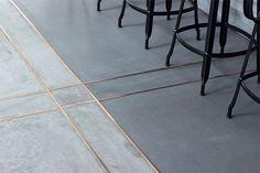 Source:http://www.dailyhomedecorations.com/decoration/concrete-styles-tiles- brass-trim-kitchen-floor/