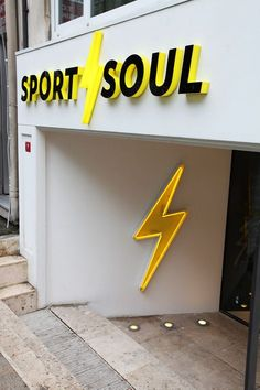 Exterior and interior store design ideas for Sport Soul. Branding included store signage, showcase design, light signage, typographic wall graphics, bookshelf, employee t-shirts, as well as all print materials from business cards to shopping bags.