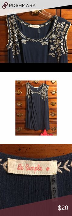 Blue dress white embroidery Deep blue shift dress with intricate white embroidery. Worn once to a dinner party. Runs a little small in terms of length. Looks great belted or flowing. Dresses