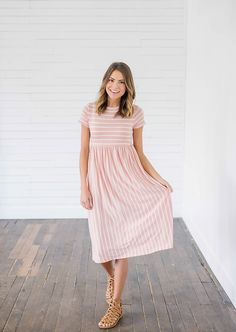 Pretty in Pastel Blush Midi Dress from Bella Ella Boutique    Online Store. Womens online boutique. Pink stripe dress. Easter dress. Midi dress. Spring dress. Online boutique. Womens fashion.