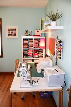 A craft room would be nice! Like the wall color and storage idea.