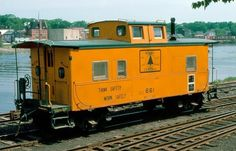 Maine Central orange steel sided caboose...
