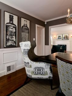 Graphic patterns, including a cheeky house-themed one, take these dining chairs from everyday to fit for entertaining. The room's gray walls provide a perfect backdrop for framed bottle prints.
