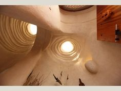 Gunoot eco resort, Oman. Built out of super Adobe which effectively comes down to filling bags with earth that are then rammed solid before being layered with more earth-filled bags. In this case self supporting domes were built that were eventually daubed over with a plaster.