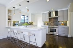 Suzie: Amoroso Design - Contemporary two-tone kitchen design with white kitchen  cabinets and ...