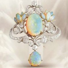 Art Nouveau opal and diamond pendant / brooch; Opal, diamond, gold and platinum floral brooch. Opal Jewelry, Bling Jewelry, Jewelry Art, Antique Jewelry, Jewelery, Vintage Jewelry, Jewelry Accessories, Jewelry Design, Jewellery Box