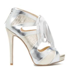 Kecia  from Shoe Dazzle  Make winter nights sparkle in this electrifying evening sandal. Kecia's flirty cutouts are enhanced by textured metallic panels and fabric lace-up styling.