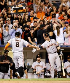 San Francisco Giants' Hunter Pence (8) is congratulated by teammate Buster Posey on his ninth inning home run against the San Diego Padres of a baseball game Saturday, Sept. 20, 2014, in San Diego. San Diego won the game 3-2.(AP Photo/Don Boomer)