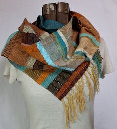 Handwoven in shades of pumpkin, teal, peacock, seafoam, avocado, chocolate, orange, khaki, rich tangerine, sky blue, variegated blue/green, tan, rust, coffee and other neutrals.