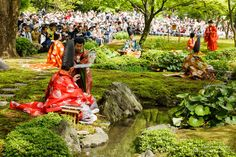 Men and women dressed in heian era robes at a Gokusui no En poetry party