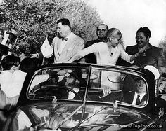 President Juan Peron at the left, and his wife, Eva, acknowledge the cheers of the crowd as they tour the Mendoza province of Argentine, 31.12.51. The occasion was the centenary of the death of the national hero, General San Martin.