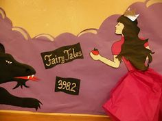 Fairy tales with big simple princess and wolf drawing and j 398.2 call number board