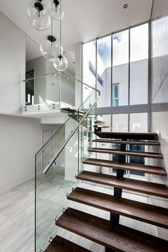 Robeson Architects- Timber stair with glass balustrade Contemporary Architecture, Interior Architecture, Inglewood House, Glass Stair Balustrade, Timber Stair, Triangle House, Glass Stairs, Exclusive Homes, Water House