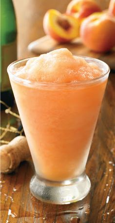Wallaby Darned (from Outback) - 1 cup frozen sliced peaches 2 ounces champagne 1 ounce peach schnapps 1 ounce vodka 4 ounces (1/2 cup) Kern's peach nectar 2 or 3 ice cubes DIRECTIONS: 1.Combine all of the ingredients in a blender. 2.Blend on highspeed for approximately 30 seconds or until ice is completely crushed and the drink is smooth. 3.Pour into a 12-ounce glass and serve with a straw.