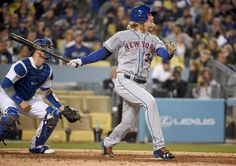 Hat-trick hit:    New York Mets starting pitcher Noah Syndergaard (34) hits a three-run home run against the Los Angeles Dodgers on May 11 in Los Angeles. The Mets won 4-3.