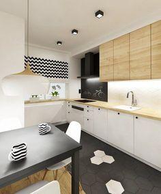 cuisine moderne bois chêne avec un plan de travail et armoires de rangement déco murale à motif chevron