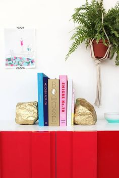 Spray paint large rocks & use as bookends. then hang a pic with striped washi tape and then make a macramé hanger for a fern.