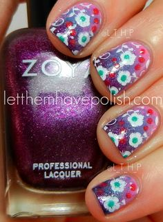 Pink to purple fade nails with a flower print.  Topped with teal and pink polka dots.