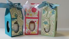 Large Votive Box with WindowsAll Abloom Designer Series Paper Stack Window Sheet Card – Island Indigo, Pistachio Pudding and Strawberry Slush Punch – Scallop Oval and 1/4″ Hand Held Circle Punch Ribbon – Island Indigo 3/4″ Chevron Ribbon, Whisper White 5/8″ Satin Ribbon and Whisper White Baker's Twine