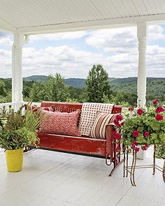 <3 red pop. Room with a view. Gorgeous garden, gorgeous porch.  The front porch of fashion designer Cynthia Steffe's home, furnished with a vintage metal glider, offers a dreamy view of t...