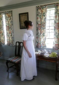 The Couture Courtesan has fashioned a delightful Regency gown with lace inserts in the bodice - very sweet!
