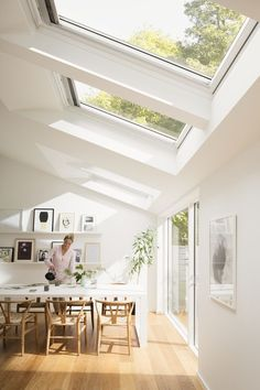 This is what I would love my new home to look like. Nice and bright with beautiful roof windows and plenty of natural light. Amazing Scandi dining room.