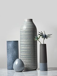 Made from clay with a textured concrete effect dark grey finish and soft blue glazed base, this slim vase is designed to stand out from the crowd. Whether displayed alone or filled with little flowers, our weighty dipped vase brings the concre Pottery Vase, Ceramic Pottery, Bud Vases, Flower Vases, Home Decor Accessories, Decorative Accessories, Keramik Design, Creation Art, Decoration Plante