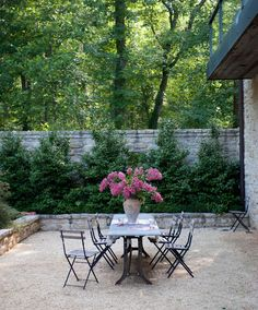 Gravel Patio. French style gravel patio with stone garden walls. Gravel patio…