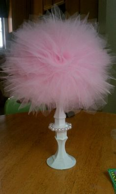 2 candle holders, foam ball and tulle.