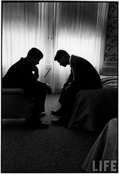Iconic image of then Senator John F Kennedy discussing the prospects of running for President with brother Robert F Kennedy~