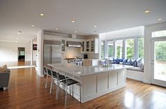 I like the different take on a kitchen window seat.  Source: Hamptons Real Estate Firm