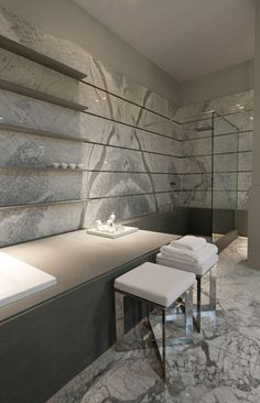 Elegant bathroom in neutral tones by Lopez Penas for Casa Foa exhibition. Love the way the tile was installed to continue the lines of the floating shelving.