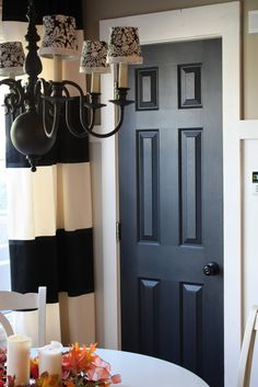 The Yellow Cape Cod: 31 Days of Character Building: Simple Builder Door Upgrades - She painted all interior doors black and replace all the builder grade trim with 1x6 and 1x4 pine boards.