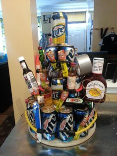 Beer & Booze Cake / Minus the BBQ and ribbon instead of bungee cords for the groom and groomsmen gifts!!!! Love it!