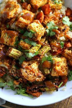 Tofu and Veggie BBQ Bowl. Veggies and Tofu tossed in from scratch barbecue seasoning and baked. Serve over quinoa dressed with bbq sauce. #Vegan #Glutenfree #Nutfree #Recipe #veganricha