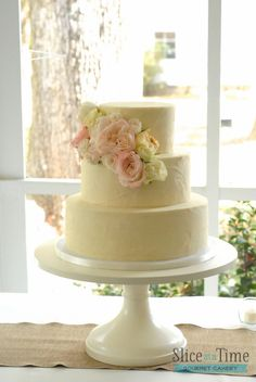 I like the placement of the sugar flowers.   Simple 3 Tier Wedding Cakes | previous next