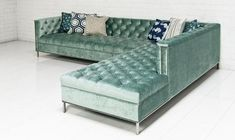 The Hollywood Sectional by ROOM SERVICE. The Hollywood sofa gets a boost in scale in the sectional. Finished in Brussels Aqua velvet fabric, polished chrome nai