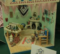 Photos of Roomboxes from the Fall 2010 Seattle Dollhouse Miniature Show: Creating a Frame for a Varied Collection