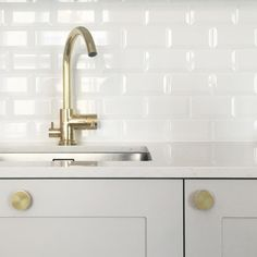 A.S.Helsingö kitchen: ENSIÖ doors and PARASOL handles in brass. Tapwell tap and IKEA cabinet frames.