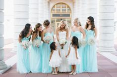 Really gorgeous bridal party - bright baby blue with baby's breath bouquets