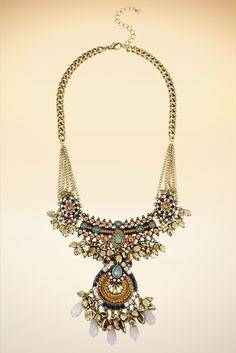 This statement necklace is ornately detailed with faceted crystals, seed beads and gold-tone bead fringe. The beauty of this necklace is that you can dress it up with a sweater ensemble or dress it down with your favorite button-down shirt.