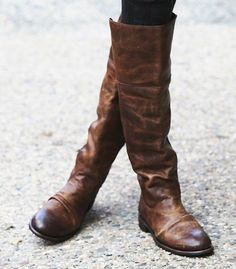 very casual, brown leather riding boots.. they look so soft and worn!