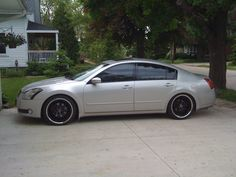 2004 Nissan Maxima... Going to be mine soon :) And then I'll have to tint the windows, and get those tires. Woo!