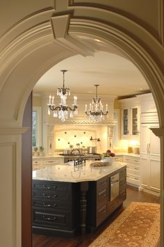 A kitchen fit for a king; beautiful archway entrance, chandelier lighting, beautiful wooden counters, and fantastic marble counter tops!