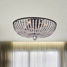 Decorate your home with the Connie 4-light Antique Black Crystal Beads Flush Mount Chandelier. This chandelier is made of crystal and iron and will look beautiful in your entryway or dining area.