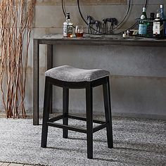 Refresh your kitchen, pub, or dining area with the backless Belfast Counter Stool from Madison Park. Upholstered in grey fabric and accented with nailhead trim, the foam-padded and contoured seat is comfortable and tailored for timeless appeal.